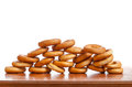 Ring shaped rolls on a wooden table Stock Photo