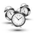 Ringing alarm clocks three on white background Stock Photography