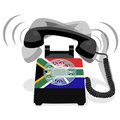 Ringing black stationary phone with rotary dial and flag of Republic of South Africa