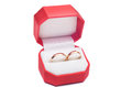 Rings in box wedding red on white background Stock Images