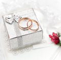 Rings, gift box and flowers for the bride. Royalty Free Stock Image
