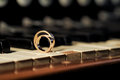 Rings on piano wedding laying keys Stock Photos