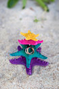 Rings on starfishes in tropic paradise wedding vacation concept gold color white beach Royalty Free Stock Image