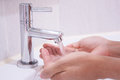 Rinsing hand by tap water Stock Photography