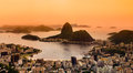Rio de janeiro brazil suggar loaf and botafogo beach viewed from corcovado at sunset Stock Photos