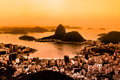 Rio de janeiro brazil suggar loaf and botafogo beach viewed from corcovado at sunset is the summer olympic games Royalty Free Stock Photos