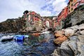Riomaggiore cliff boats and colored houses of in italy Royalty Free Stock Photography