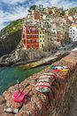 Riomaggiore italy europe village on cliff rocks and sea seascape in five lands cinque terre national park liguria Stock Image