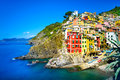 Riomaggiore village rocks and sea at sunset cinque terre ligu on cliff seascape in five lands national park liguria italy europe Royalty Free Stock Image