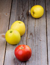 Ripe apples arrangement of red apple and golden delicious on rustic wooden background Stock Photo