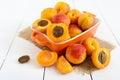 Ripe apricots in a ceramic bowl