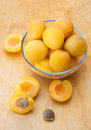 Ripe apricots in glass bowl on wooden board group of Royalty Free Stock Photos