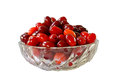 Ripe berries of dogwood red in a glass on the background.