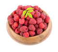 Ripe berries heap of raspberries in bamboo plate on white background Royalty Free Stock Photography