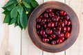 Ripe black cherries in a clay bowl Royalty Free Stock Photo
