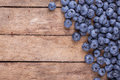Ripe blueberries on a wooden background Royalty Free Stock Images