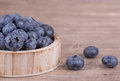 Ripe blueberries on a wooden background Stock Photo