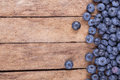 Ripe blueberries on a wooden background Stock Photos