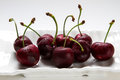 Ripe cherries on white dish Royalty Free Stock Images