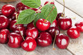 Ripe cherries on wooden table heap Stock Image