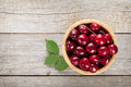 Ripe cherries on wooden table Royalty Free Stock Photo