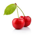 Ripe cherry berries with green leaf isolated on white Stock Image