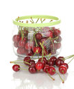 Ripe cherry berries in jar Stock Photography