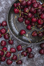 Ripe cherry on a black plate Royalty Free Stock Photo