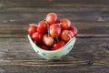 Ripe cherry in a bowl on the table Royalty Free Stock Photography