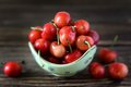 Ripe cherry in a bowl on the table Stock Photo