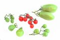 Ripe cherry and green unripe tomatoes isolated on white background Royalty Free Stock Images