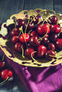 Ripe cherry in an old vase Royalty Free Stock Photo
