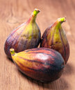 Ripe figs on wooden basis rustic Stock Photos