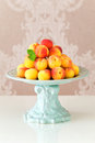 Ripe fresh apricots in a vase on table selective focus Royalty Free Stock Photos