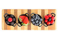 Ripe fresh autumn berries in separate dishes selection of different including strawberries blueberries blackberries and Royalty Free Stock Photo