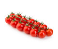 Ripe fresh cherry tomatoes on branch isolated on white background. Royalty Free Stock Photo