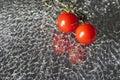 Ripe Fresh Cherry Tomatoes on Broken Mirror Glass Royalty Free Stock Photo
