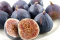 Ripe fruits of a fig on white Stock Photos