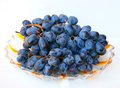 Ripe grape on plate white background Stock Photos