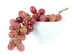 Ripe grapes close up of red in white bowl on white Stock Photography