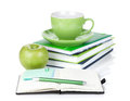 Ripe green apple, coffee cup and office supplies Stock Photo
