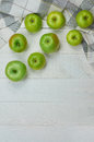 Ripe green apples on light wooden background nature fruit concept top view close up selective focus Royalty Free Stock Image