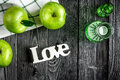 Ripe green apples with love dark wooden table background top view space for text