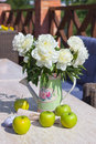Ripe green apples vase peonies table Royalty Free Stock Photography