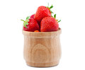 Ripe, juicy strawberries imposed in a wooden bowl. Royalty Free Stock Photo