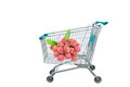 Ripe litchi fruits in shopping trolley cart on white background Royalty Free Stock Photo