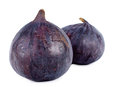Ripe luscious purple figs fresh whole close up view showing the texture of the surface of the skin over white Royalty Free Stock Image