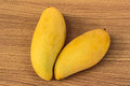 Ripe mangoes two on wood table stock photo Royalty Free Stock Image
