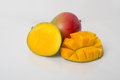 Ripe mangos a display of a mango with a full half and a cube cut half Royalty Free Stock Image