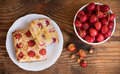 Ripe organic homegrown cherries and cherry cake on wooden background Royalty Free Stock Images